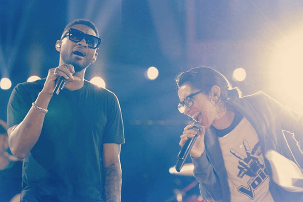 Usher and Michelle Chamuel performing on 'The Voice'