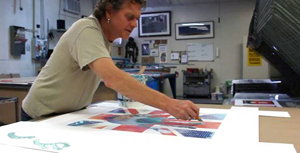 Rick Allen hard at work on one of his art pieces.
