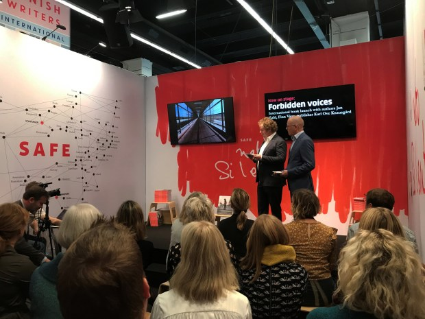 Stavanger Aftenblad's journalists and authors of Forbidden voices, Jan Zahl and Finn E. Våga, presents the project to the audience during the booklaunch at ICORN's stand at the Frankfurt Book Fair 2019. Photo.