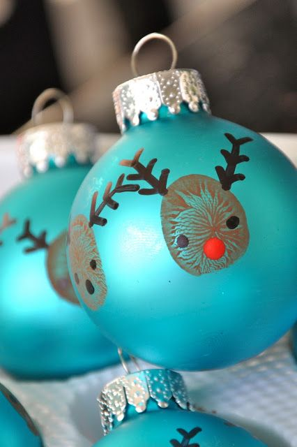 40+ Creative Handprint and Footprint Crafts for Christmas --> Thumbprint Reindeer Christmas Ornaments