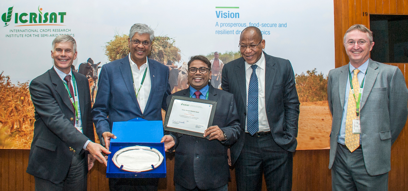 Dr Varshney being presented with Doreen Margaret Mashler Award for 2016 by ICRISAT Governing Board Chair Prof Madramootoo and ICRISAT leadership. Photo: PS Rao, ICRISAT