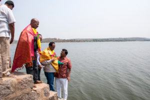 HE Abraha Alle with officials at the Narsapur reservoir (tank).