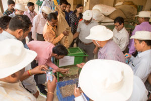Groundnut Network Group-Asia participants observing battery operated sheller for use in breeding programs. Photo: ICRISAT