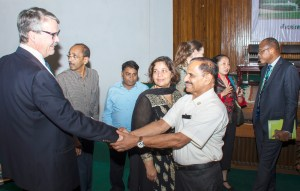 Laurie Craig Tollefson, ICRISAT Governing Board member, greets Dr Wani at the symposium. Photo: S Punna, ICRISAT