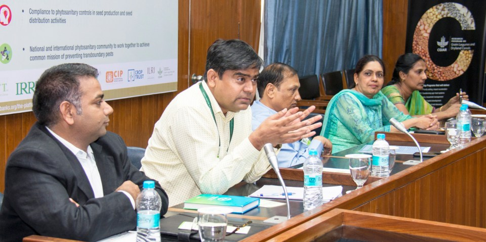 Dr Rajan Sharma, Head, Plant Quarantine Unit, ICRISAT, speaking as (L-R) Dr Rajeev Varshney, Director, Research Program – Genetic Gains, ICRISAT; Dr Pooran Gaur, Director, Research Program – Asia; Dr Kavita Gupta, Principal Scientist, Division of Plant Quarantine, ICAR-NBPGR; and Dr J Alice RP Sujeetha, Director (Plant Biosecurity), NIPHM, look on during the seminar. Photo: S Punna, ICRISAT