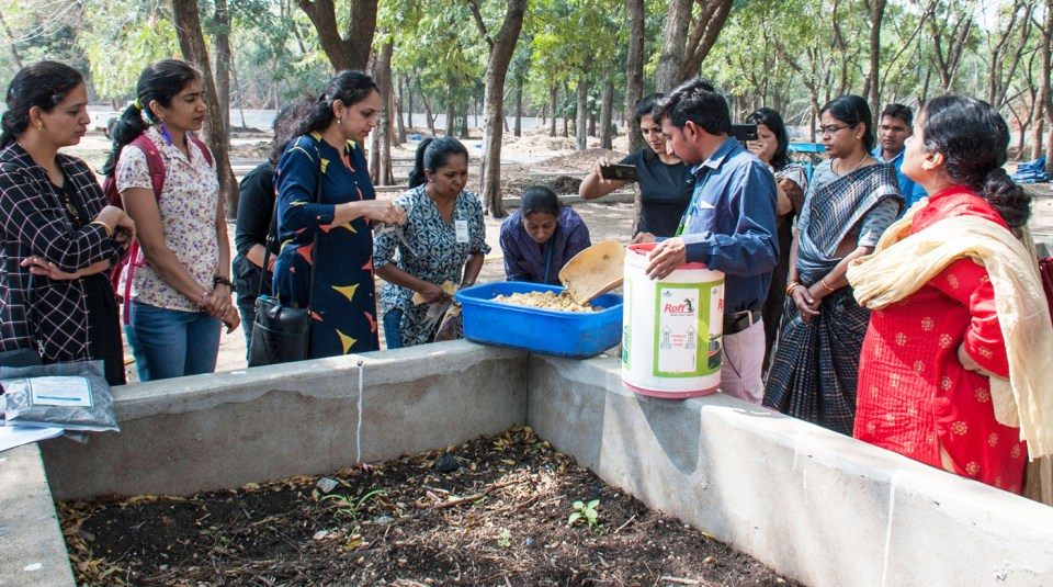 Dr Pasumarthi conducts a demo on how to compost kitchen waste. Photo: PS Rao ICRISAT