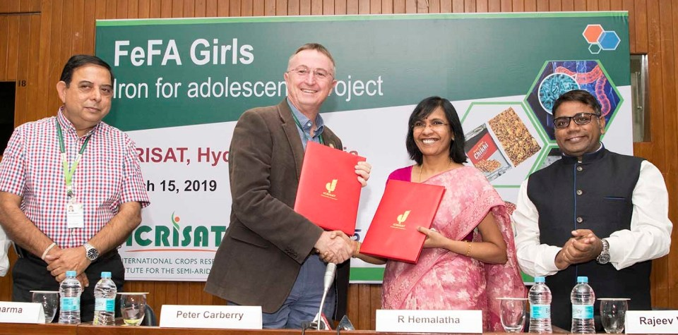 (From L-R) Dr. Kiran Shrama, Deputy Director General, ICRISAT; Dr. Peter Carberry, Director General ICRISAT, Dr. R Hemalatha, Director of NIN and Dr. Rajeev Varshney, Research Program Director for Genetic Gains, ICRISAT exchanging MoUs