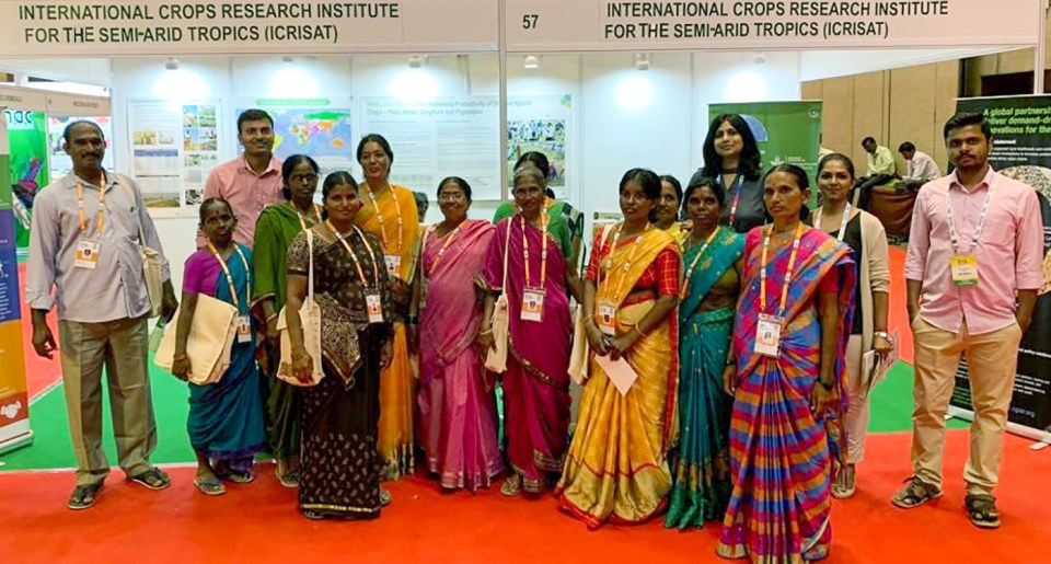 ICRISAT delegation at the ISTA Congress, with a group of women farmers that visited the stalls. Photo: ICRISAT