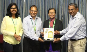 Ms MarMarNwe, a former collaborator from the Department of Agricultural Research, Myanmar, who is currently helping seed systems in Myanmar as consultant of OFID project, was felicitated for her contributions to groundnut research in Myanmar by Dr Pooran Gaur, Research Program Director-Asia, and Dr SN Nigam (far right), former Prinicipal Scientist-Groundnut at ICRISAT.