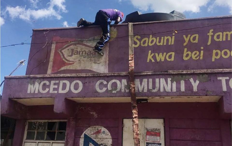Self-organized refill of water in Mathare, informal settlements in Nairobi, 23 Mar 2020. Photo: Billian Ojiwa