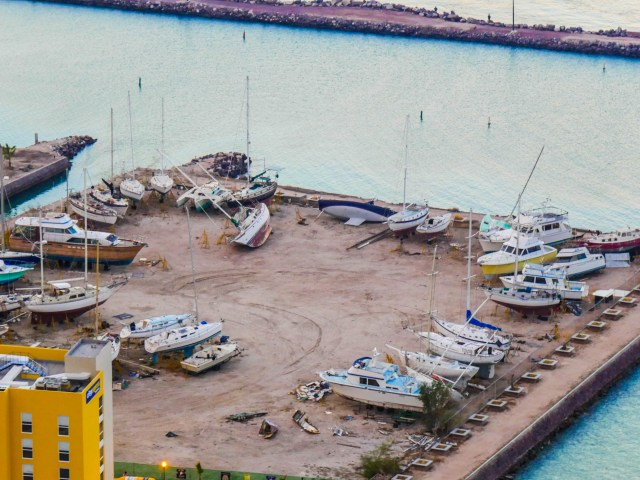 Boats remain toppled in a La Paz boatyard a year after Hurricane Odile knocked them down.
