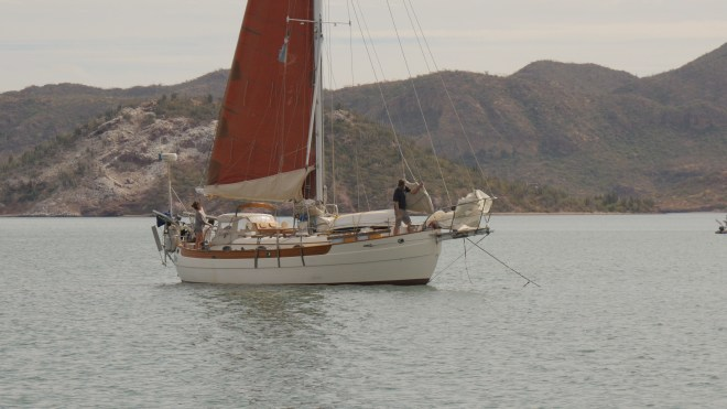 Jon and Shannon aboard Prism haul up the anchor in Guaymas harbor.