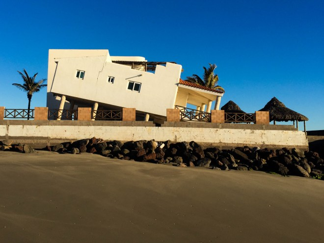 Despite a rock wall, the beach in front of the house gave way to the Pacific, leaving the luxury home nosediving into the sea.