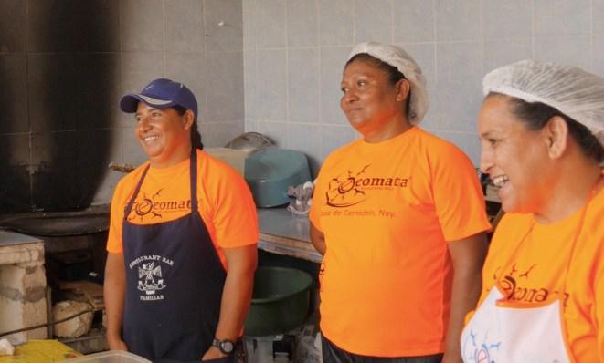 Talking in the kitchen with Aurora, Josefina, and Yolanda.