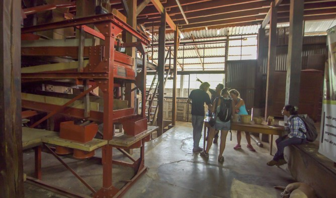 Bruno points out one of the last steps in the coffee-making process, the kiln that removes the papery husk from the bean.