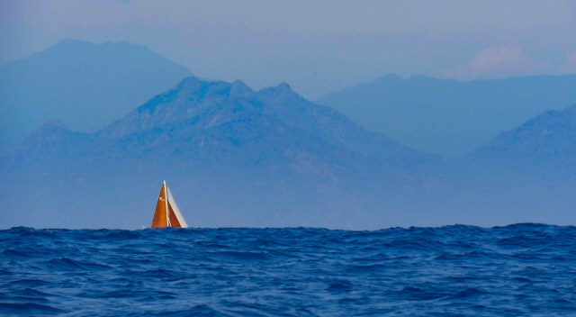 Sailing vessel Prism disappears beneath the swell in the Gulf of Tehuantepec.