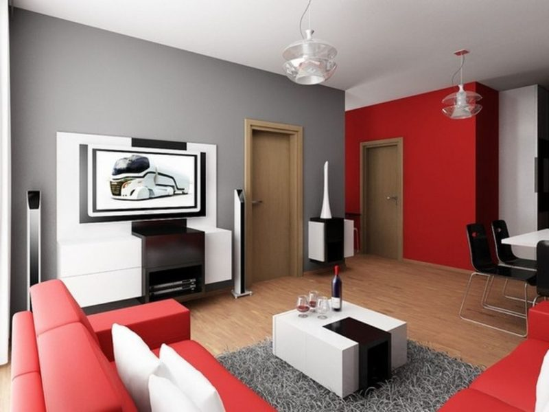 Ideas for Decorating your First Apartment Without Splurging   Ideas     Stylish White Table and Red Sectional Sofa inside Living Area Apartment  Decorating Ideas with Carpet Rug