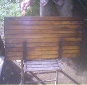 scudo di legno restaurato
