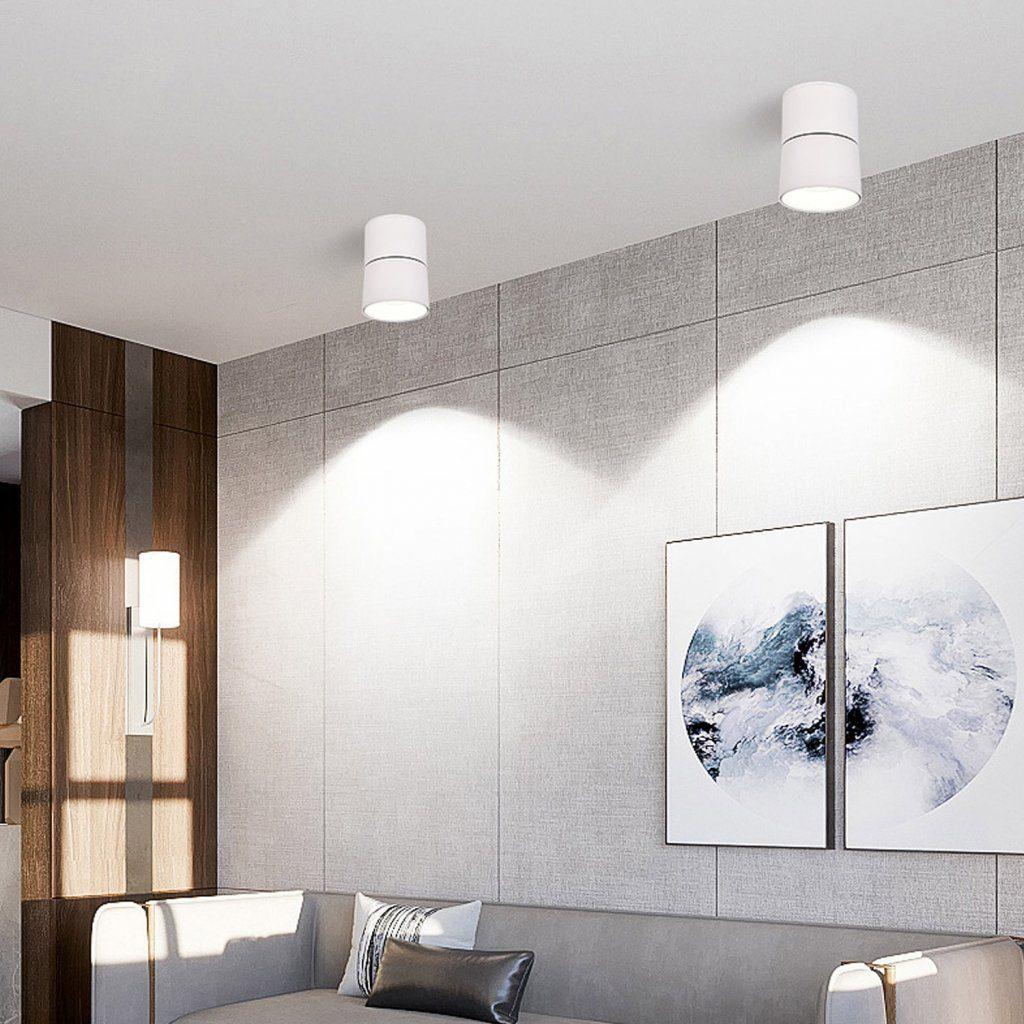 CRETEIL - Applique ronde saillie blanche 15W CCT tricolor IP20 au plafond d'un salon