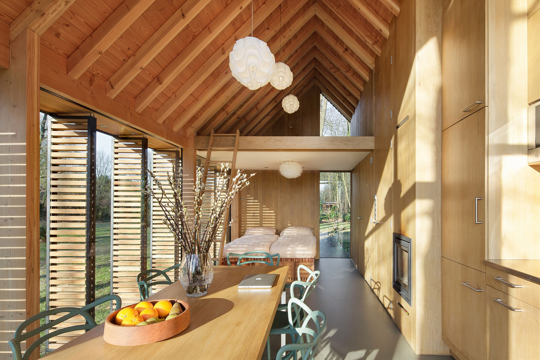 Modern Small Country Cottage With Wooden Shutters In The