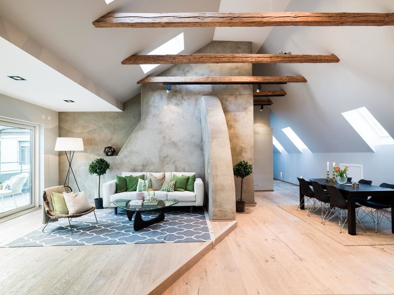 Scandinavian Attic Apartment With Wood Floors And Warm