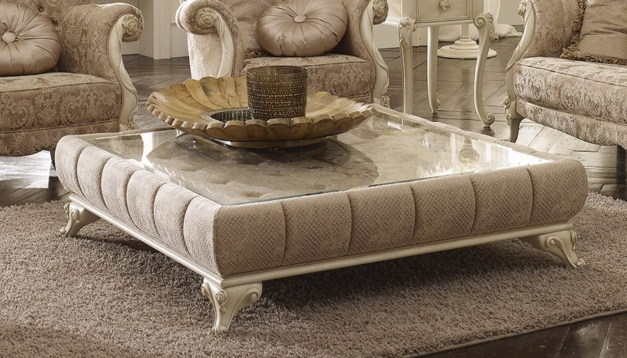 padded coffee table with glass top