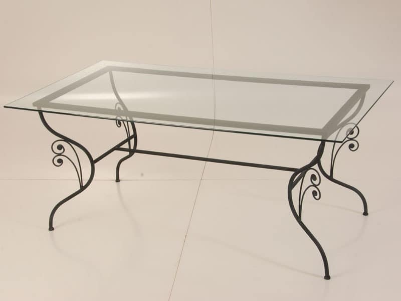 table made of wrought iron glass top