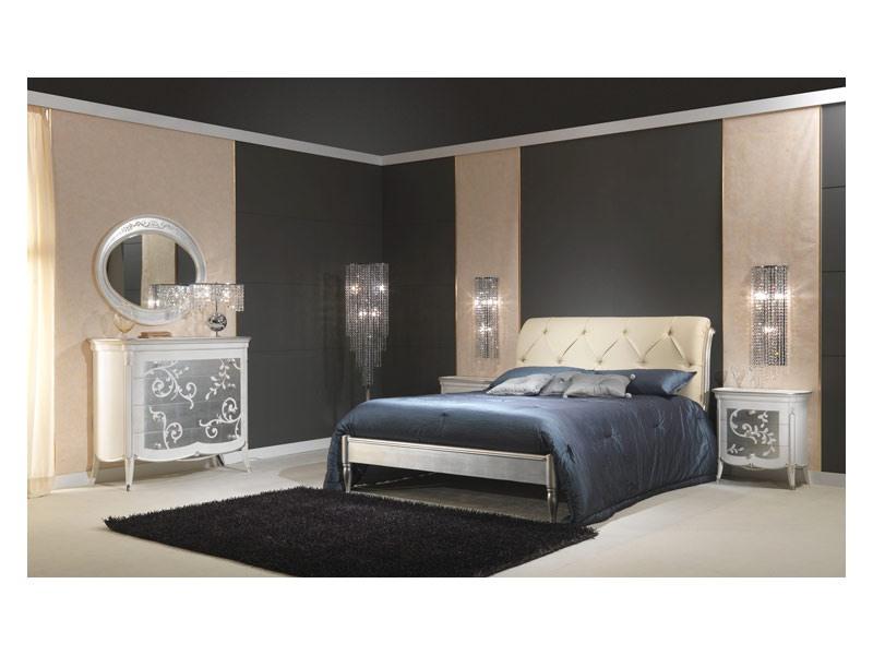 lit en bois avec finition argent tete