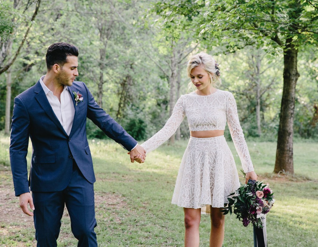 Newly married couple with forest backdrop