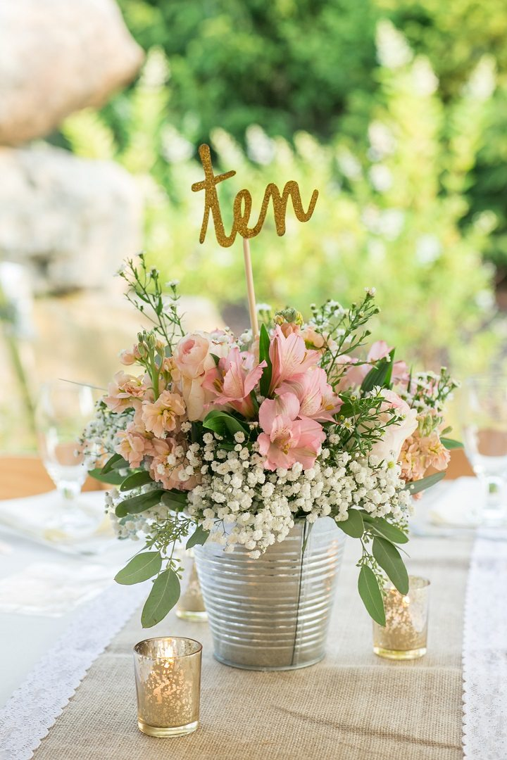 14 rustic wedding table decorations we love for Northwoods decor