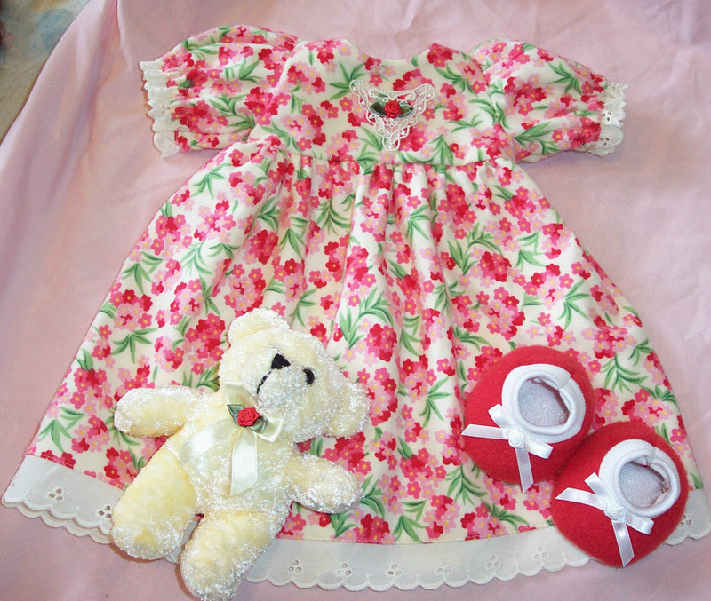 pink floral doll gown on bed