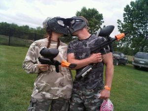 Kathy and Kirk Haan kissing after paintball