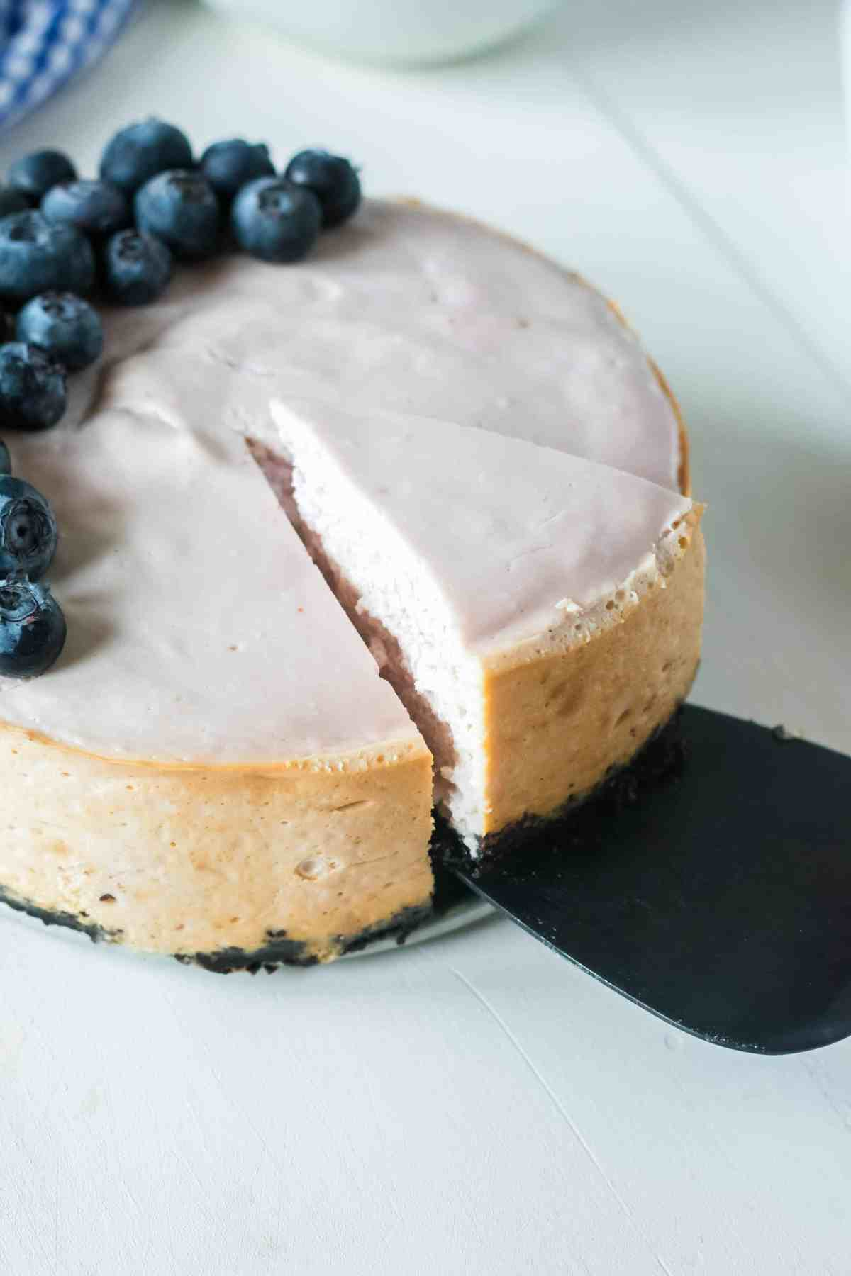 serving blueberry cheesecake