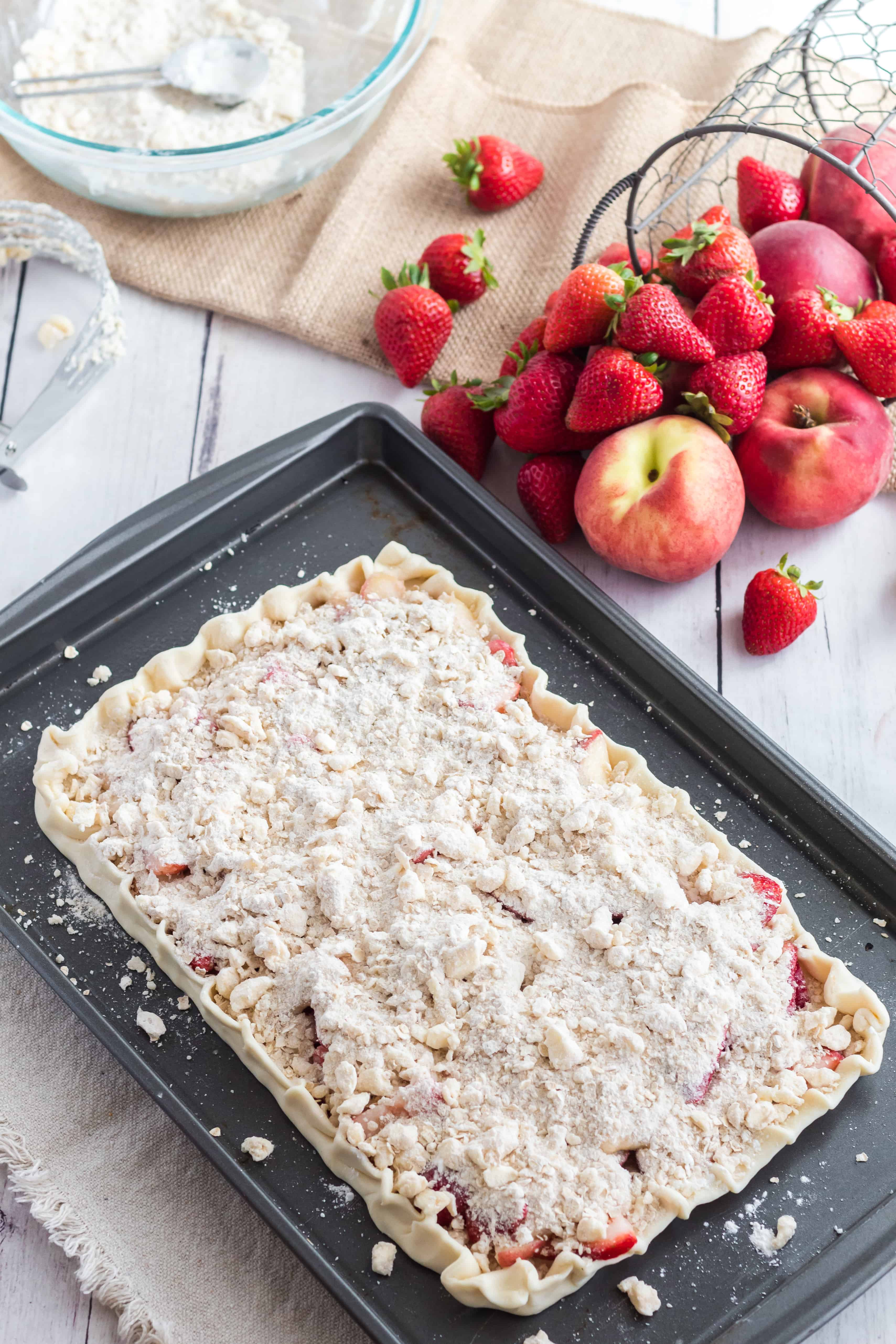 The crumbly mixture should cover the top of the fruit in The best white peach strawberry bars