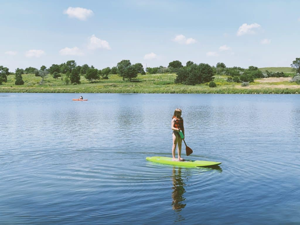 Stand up paddle boarding at Littlefield Recreational Area near Audubon, Iowa