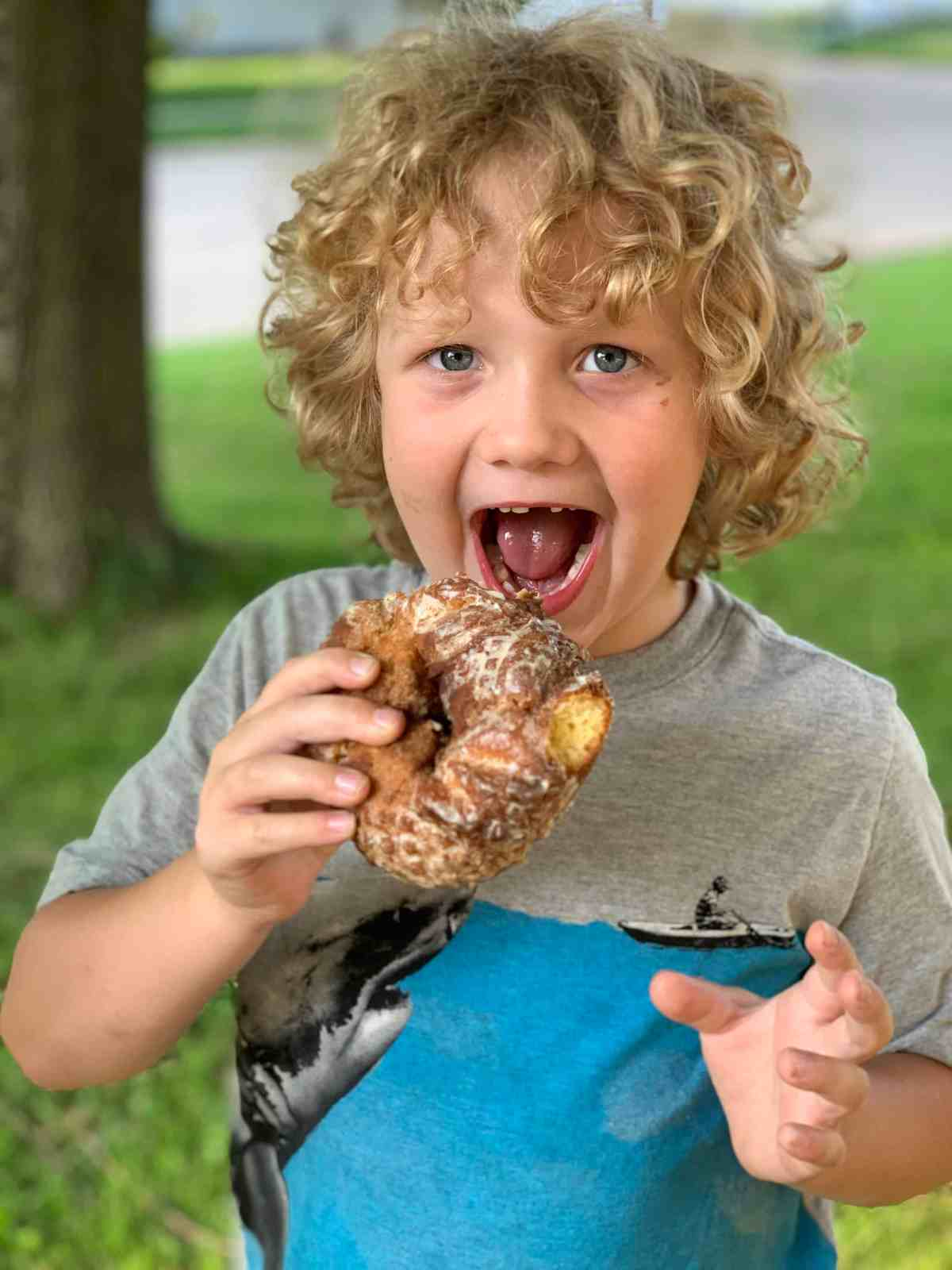 Butler County Donut Trail preschooler eating a donut