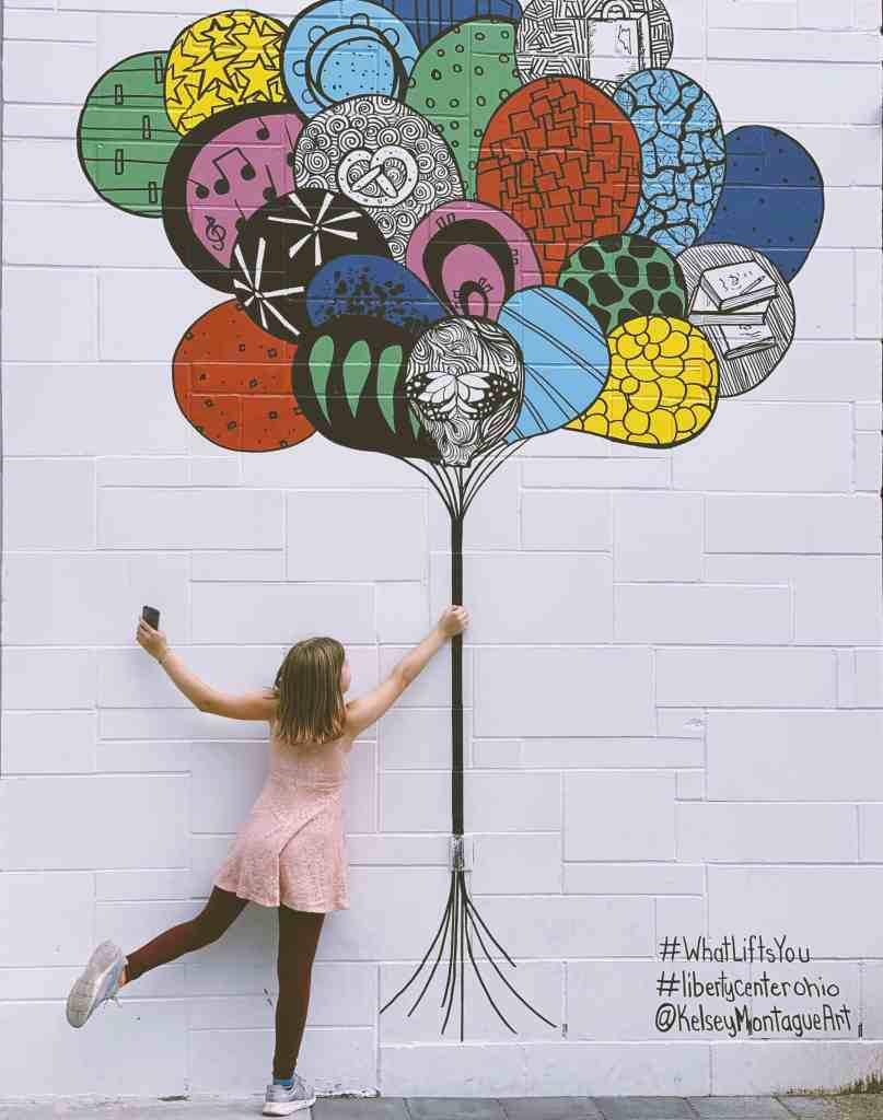 Visit Butler County Ohio to see the famous #whatliftsyou Kelsey Montague art murals