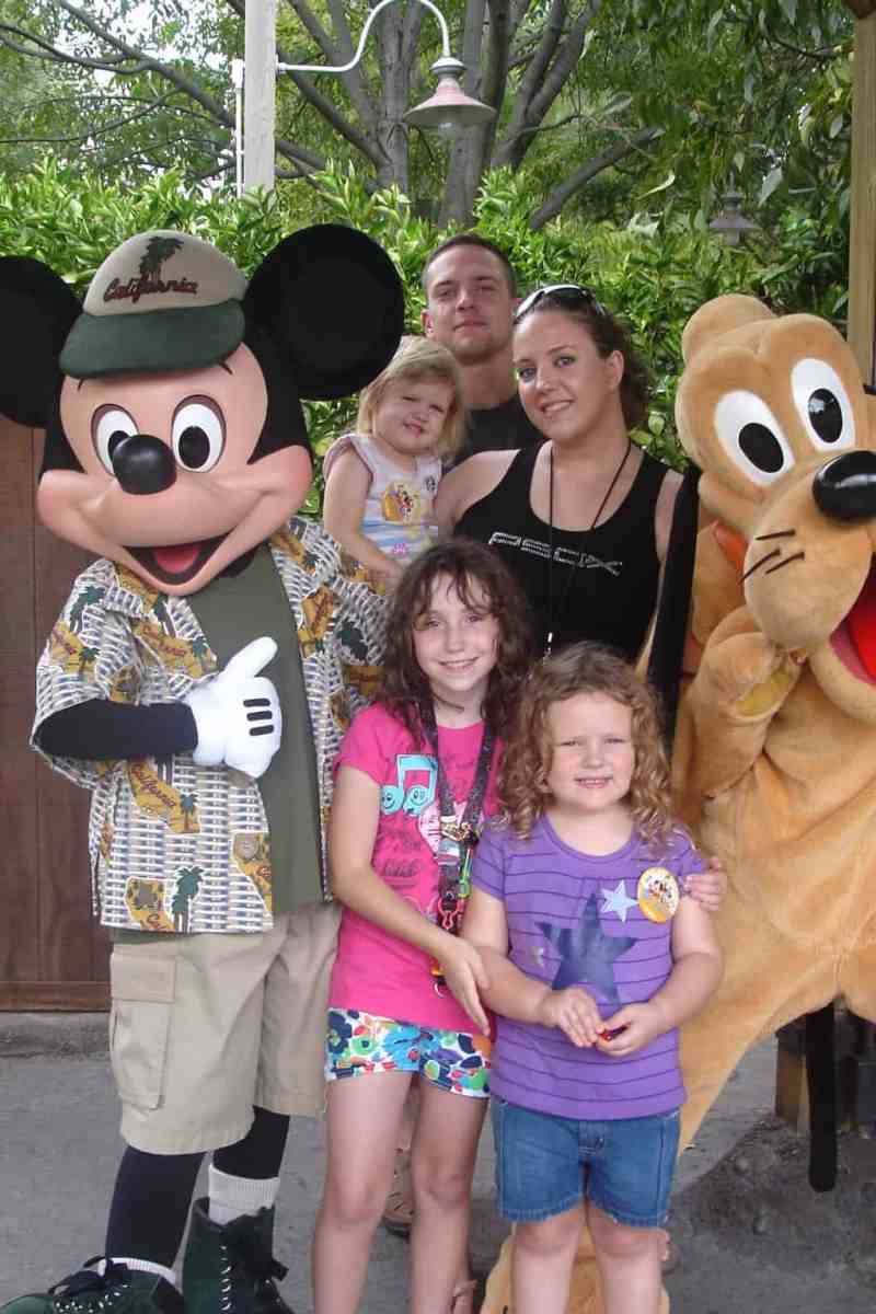 Posing with Mickey and Pluto! The best no wait Disneyland rides