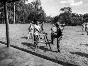 Demonstrating how to use a Kenyan ladder at Enonkishu Conservancy in Kenya
