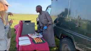 Placing our breakfast orders after hot air ballooning in the Maasai Mara, Kenya