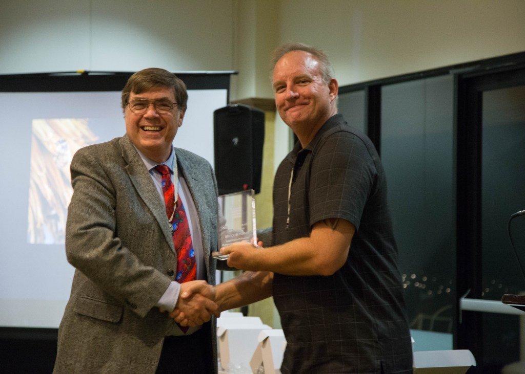 Nature Photographer of the Year - Bruce Bonnettreceives his award from Steve Burgraff