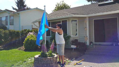 Nick raising the FSM flag in front of our house.