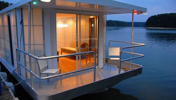 EcoFriendly Rev House Houseboats Are Floating Luxury - Modern custom houseboat graphics