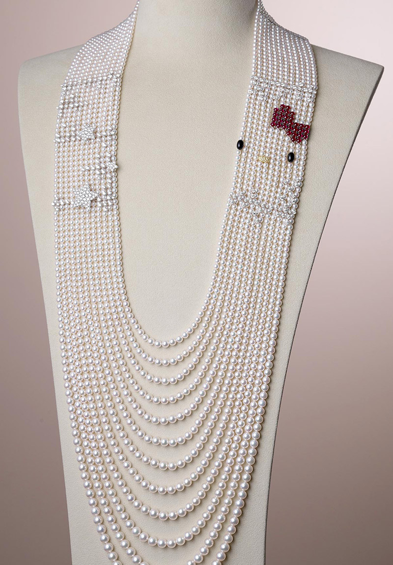 9396a3bda The necklace is made of multiple strands of luxurious Akoya pearls accented  with diamonds, Hello Kitty's trademark bow made of deep red rubies, pave  diamond ...