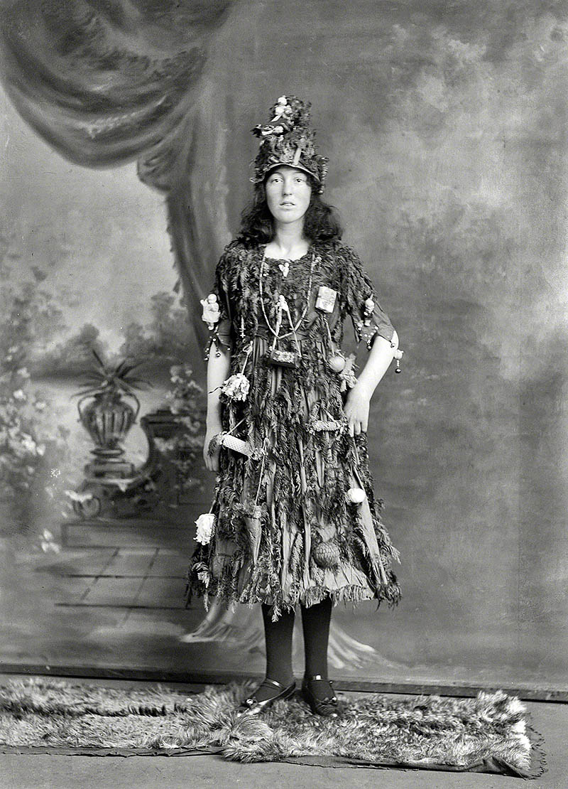 studio portrait young woman in christmas tree fancy dress and - Vintage Christmas Photos
