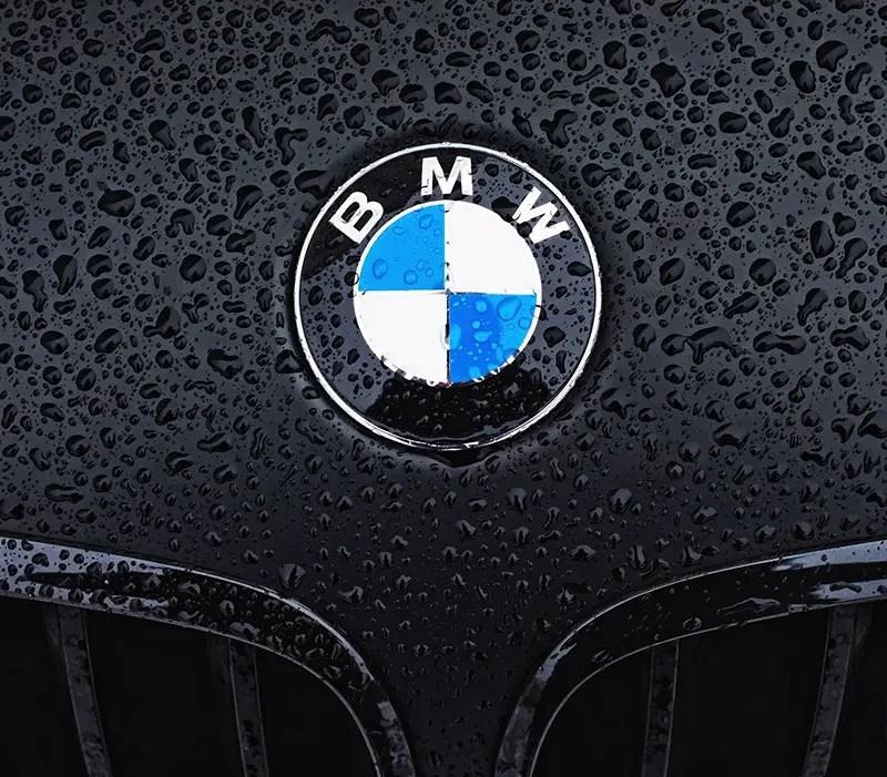 bmw on wet hood