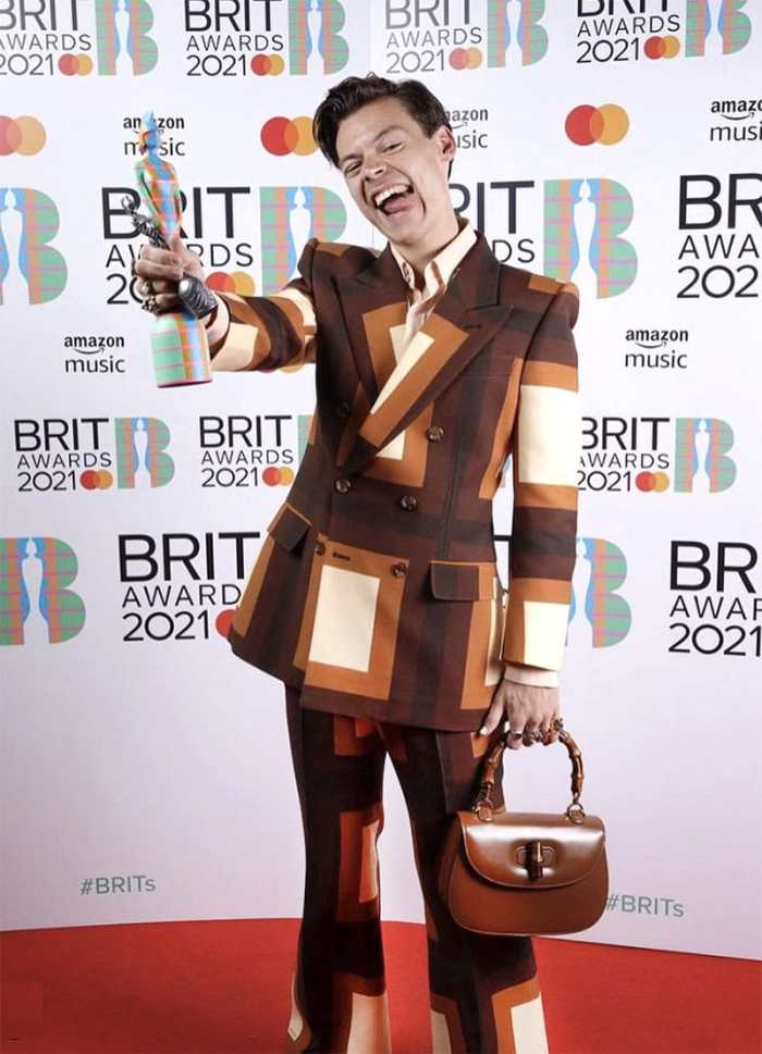 harry styles patchwork suit and handbag 2021 brit awards