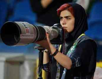 ifmat - Iranian female photographer banned from stadium covers match