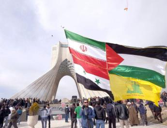 ifmat - Angry Iranians tear down image of Iranian forces killed in Syria