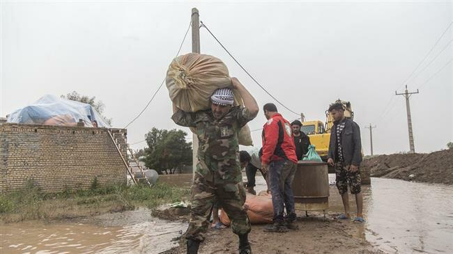 ifmat - Floods expose divide between government and IRGC